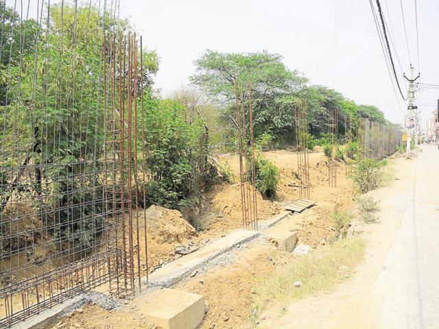A portion of the boundary wall of the Hindon airbase is under construction.