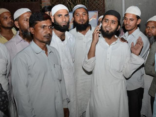 24-year-old Mohammed Muzahir (talking on phone), an Imam from Askha mosque in Loni, was freed by Delhi Police special cell after several days of detention.