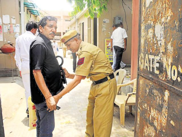 Gurgaon, India- May 06: Haryana police personnel checking a visitor at the entry in district court, in Gurgaon, India, on Friday, 06 May 2016. (Photo by Parveen Kumar/Hindustan Times)