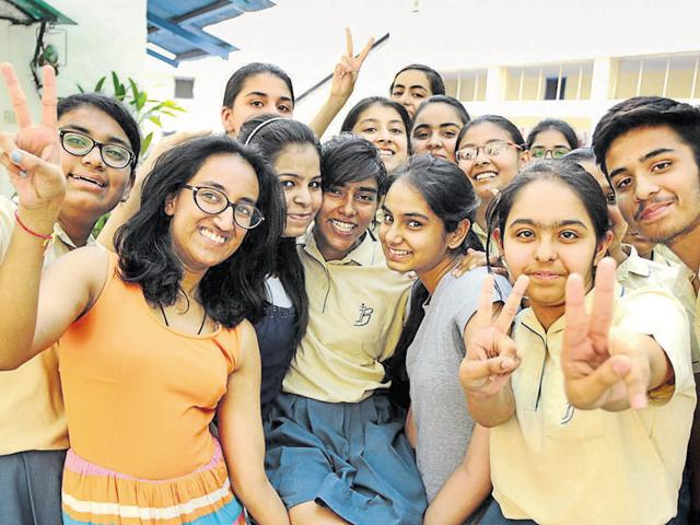 Students celebrating after the ICSE results were declared at The British Co-ed High School in Patiala on Friday. As many as 96 students had appeared from YPS, Patiala, in Class 12 examination, of which 18 scored more than 90% marks.