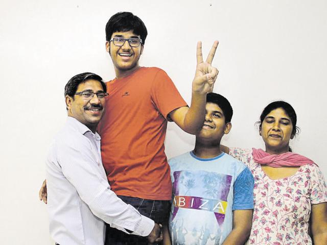Tarush Goyal celebrating with family in Ludhiana on Friday.
