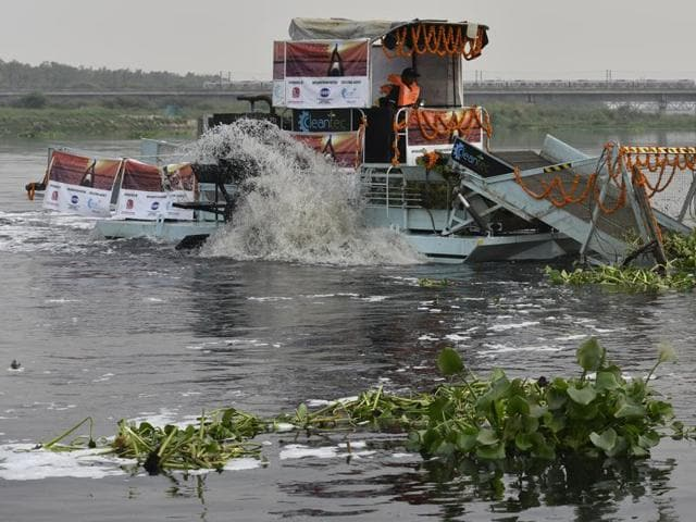 A trash skimmer at work on the Yamuna on Saturday. One machine costs Rs 4.5 crore