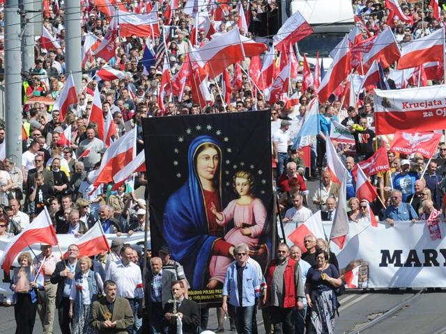 Nationalist and Catholic activists march through the downtown in a protest against the European Union, in Warsaw, Poland.