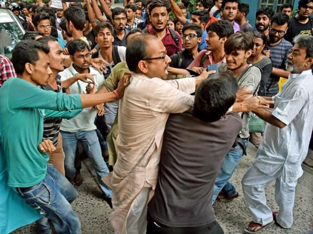 ABVP activists clash with Jadavpur University Students  during their agitation against screening of 'Buddha in a Traffic Jam' .
