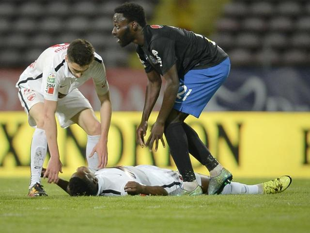 Dinamo Bucharest's Patrick Ekeng of Cameroon lies on the pitch after collapsing during a league game in Bucharest, Romania on Friday.