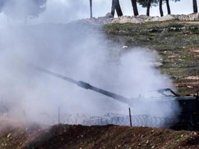 A Turkish tank fires from an army position near the Oncupinar crossing gate close to the town of Kilis, south central Turkey, towards the Syria border.