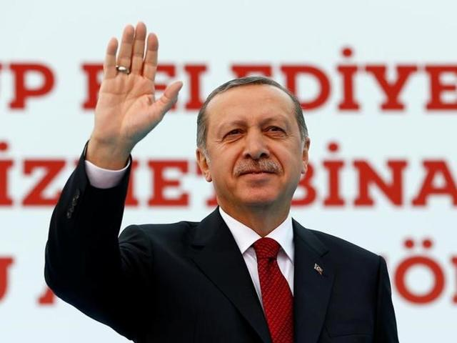 Turkish President Tayyip Erdogan greets his supporters during an opening ceremony in Istanbul.