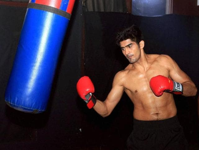 Boxer Vijender Singh practices before his next professional boxing bout against Matiouze Royer at Manchester Arena.