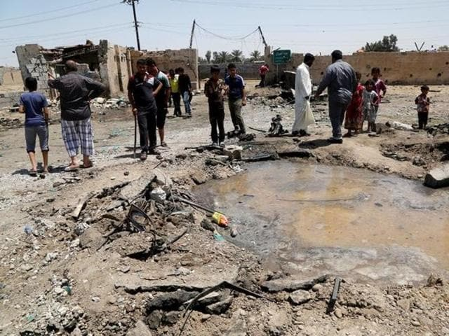 Multiple attacks in and around Iraq killed at least 12 people. Police say the deadliest in today's attacks was in Baghdad's western suburb of Abu Ghraib where a suicide bomber blew up himself outside a funeral tent for the wife of a local official, killing three policemen and two civilians.