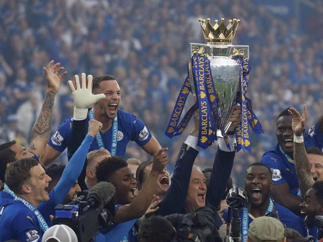 Leicester goalkeeper Kasper Schmeichel lifts the trophy as Leicester City celebrate becoming English Premier League champions at King Power stadium in Leicester, on May 7, 2016.
