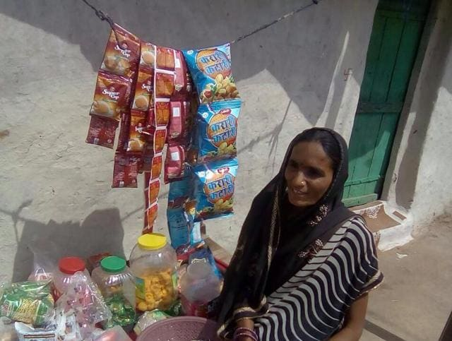 Former Sheopur district panchayat chairperson Guddi Bai at her roadside toffee and biscuit stall in Sheopur.