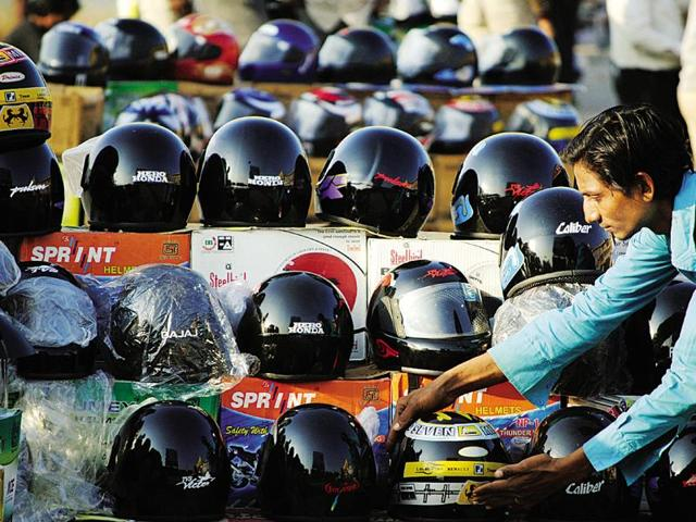 Volunteers would be deployed at main gates of colleges to check students wearing helmets.
