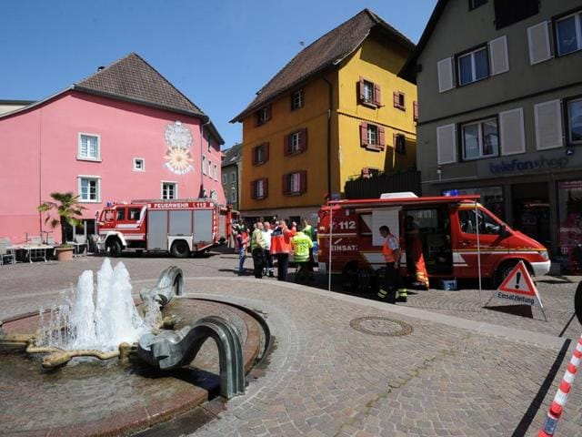 Rescue workers stand in the pedestrian zone in Bad Saeckingen, Germany.