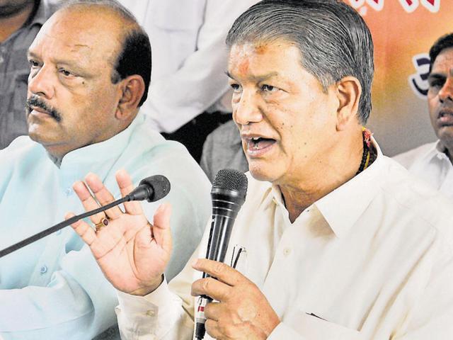 Former chief minister Harish Rawat addresses the media in Dehradun on Sunday.