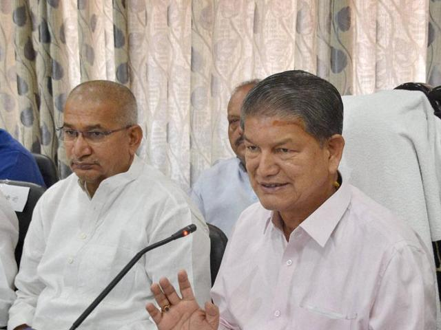 In this file photo, former CM Harish Rawat can be seen addressing a press conference in Dehradun.