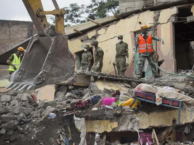Rescuers standing on the sandwiched floors of the collapsed building continue the search for survivors at the site of last week's building collapse in the Huruma neighbourhood of Nairobi, Kenya.