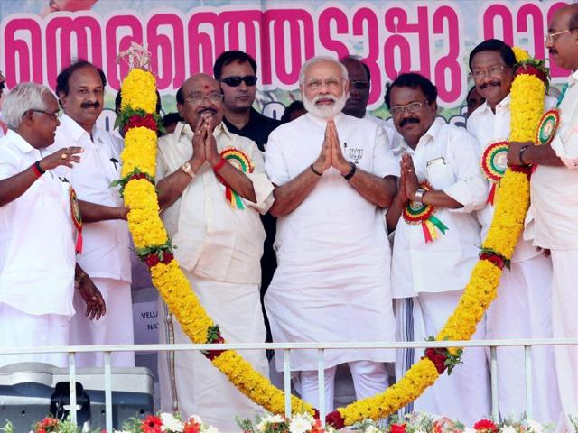 Prime Minister Narendra Modi garlanded at an assembly elections meeting at Alappuzha in Kerala.
