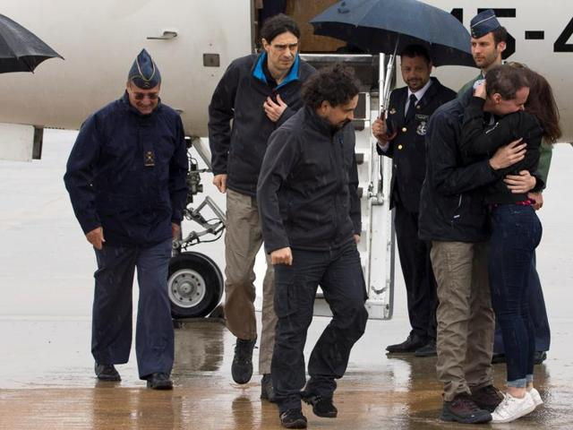 Antonio Pampliega (R), Jose Manuel Lopez (L) and Angel Sastre, three Spanish freelance journalists who went missing in Syria last year and were believed to have been kidnapped, arrive at Torrejon's military airport after been released, near Madrid, Spain.