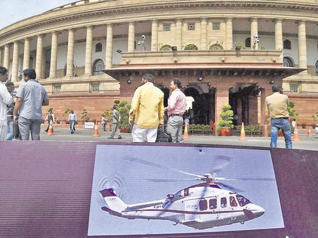 A placard bearing an image of an AgustaWestland chopper lies on the Parliament lawn after a protest over the scam.