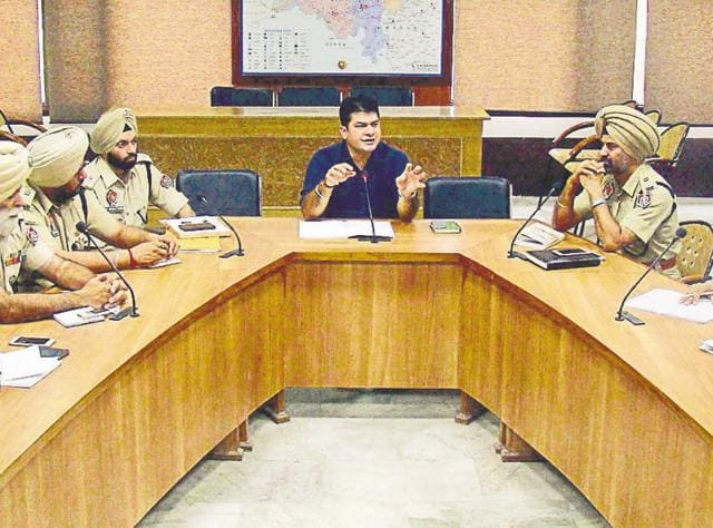 SSP Swapan Sharma (C) during a meeting with other police officers in Bathinda on Saturday.