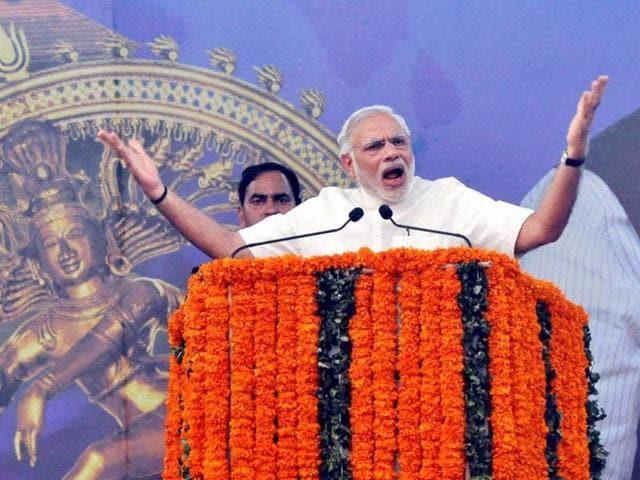 Prime Minister Narendra Modi addresses a public meeting in Thrissur.