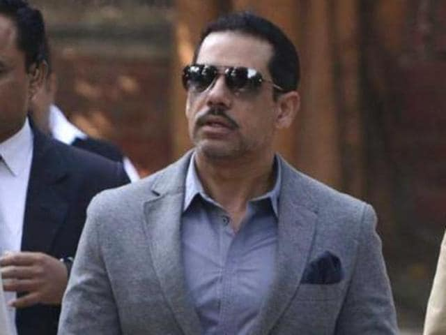 BJP MP has given a notice in Lok Sabha to raise the alleged scams involving Robert Vadra .