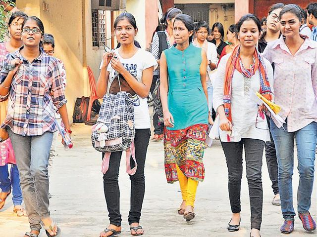 Students coming out from an examination centre after appearing in CLAT in Patna on Sunday.