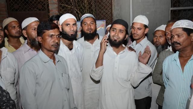 24-year-old Mohammed Muzahir (talking on phone), an Imam from Askha mosque in Loni, was freed by Delhi Police special cell after several days of detention. (Sakib Ali/Hindustan Times)