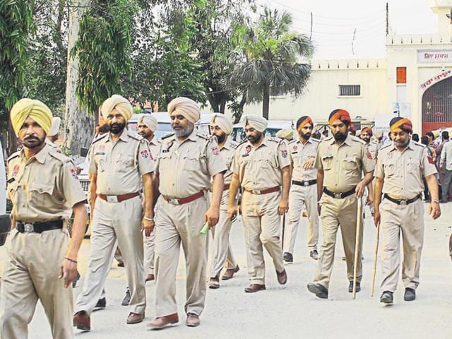 Policemen during the raid at the district jail in Sangrur on Sunday.