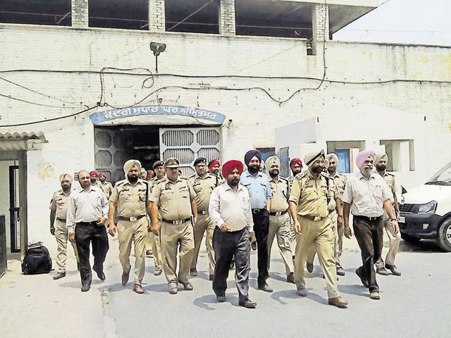 Police commissioner Amar Singh Chahal coming out of the Amritsar central jail after conducting a raid.