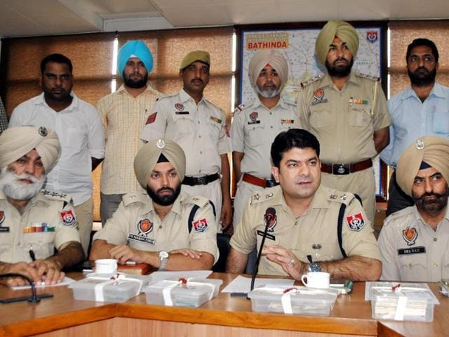 Police interacting with the media during a press conference in Bathinda on Monday.