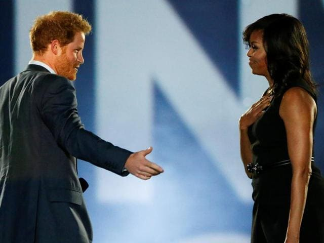 Britain's Prince Harry and US First Lady Michelle Obama take part in the opening ceremonies of the Invictus Games in Orlando, Florida.