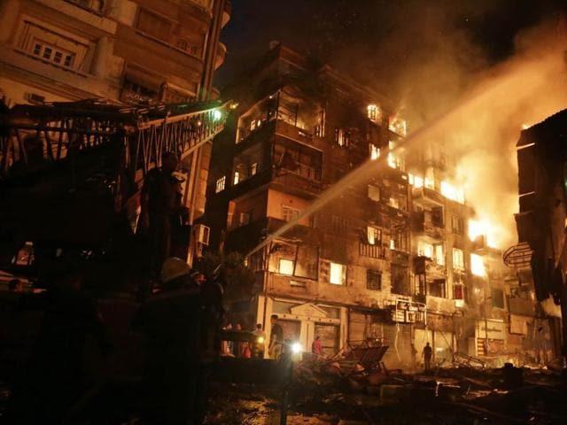 Egyptian firefighters extinguish fire at the popular market area of al-Atabaa in downtown Cairo.