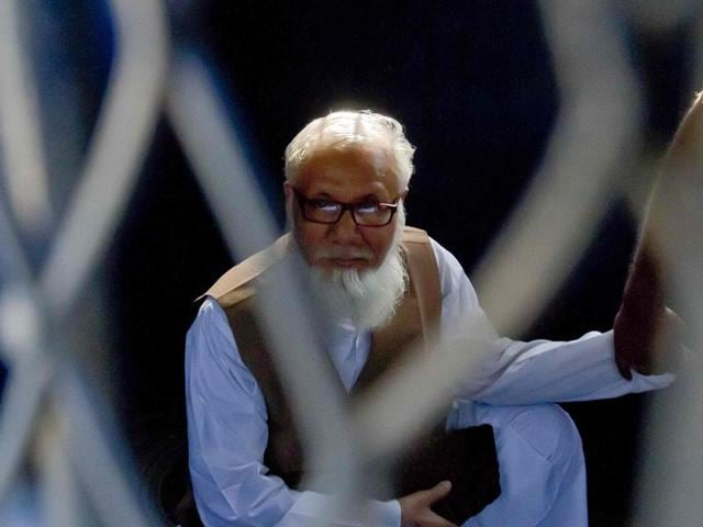 This file photograph shows Bangladeshi Jamaat-e-Islami party leader Motiur Rahman Nizami as he sits inside a van while being taken to a prison after being sentenced at the International Crimes Tribunal court in Dhaka.
