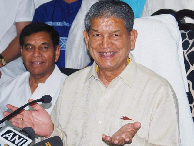 Former Uttarakhand chief minister Harish Rawat addresses a press conference in Dehradun on Sunday.