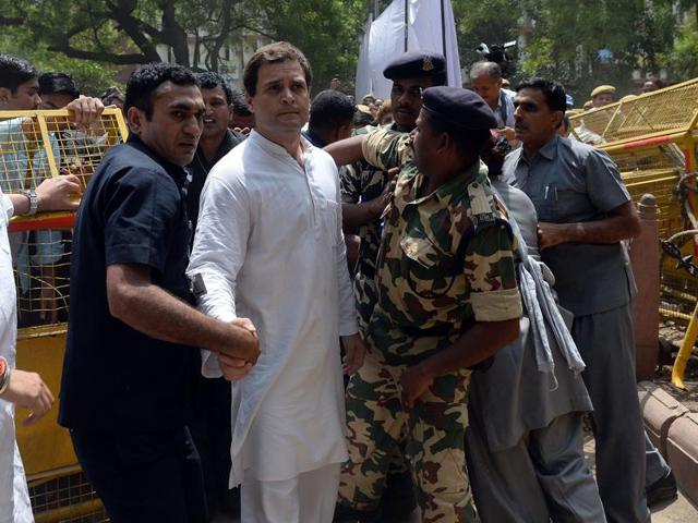Security personnel escort Congress party vice-president Rahul Gandhi (C) during the 'March for Democracy' protest against the National Democratic Alliance (NDA) government.