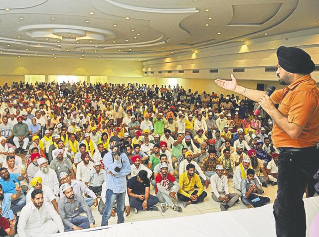 Comedian-turned-AAP leader Gurpreet Singh Ghuggi addressing party workers near Jalandhar on Sunday.