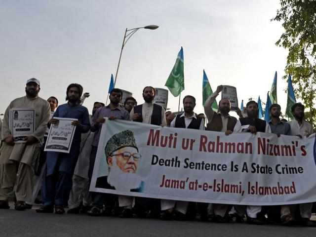 Jamaat-e-Islami Activists march in a protest against the death sentence for Motiur Rahman Nizami in Islamabad on Sunday.