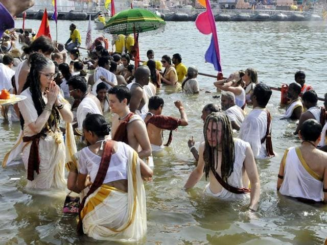 Naga Sadhus took a holy dip at Dutta Akhara Ghat in Kshipra river in Ujjain on Monday on the occasion of second Shahi Snan.