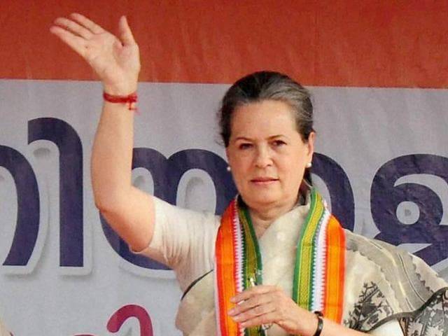 Congress president Sonia Gandhi waves during an election rally for upcoming assembly polls in Thrissur.