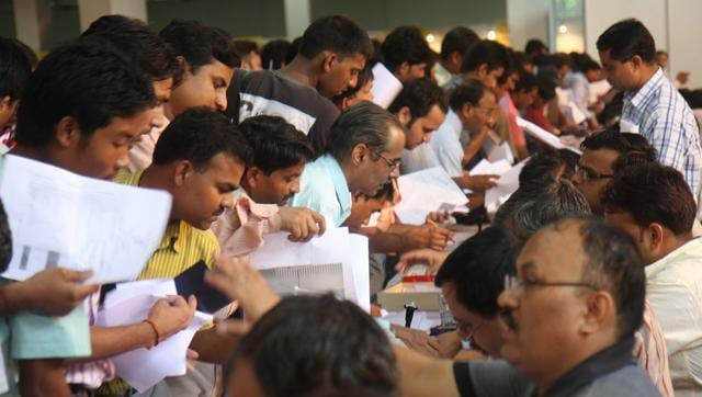 A file photo showing people submit their Income tax return form at Pragati Maidan in New Delhi.