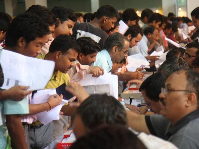 In this file photo, people submit their income-tax return forms at Pragati Maidan in New Delhi.