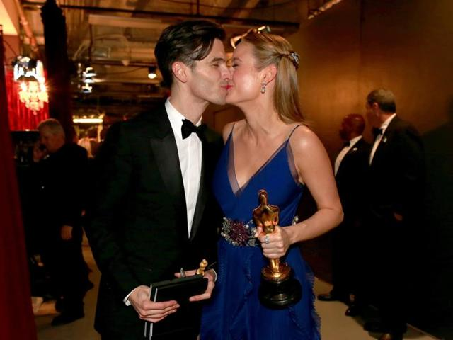 Brie Larson, Best Actress winner for her role in Room, and her boyfriend Alex Greenwald kiss at the Governors Ball following the 88th Academy Awards in Hollywood.