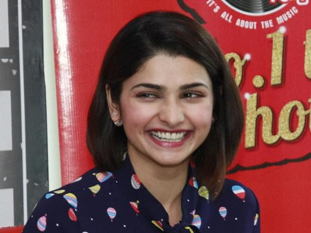 Prachi Desai smiles during interaction with fans.
