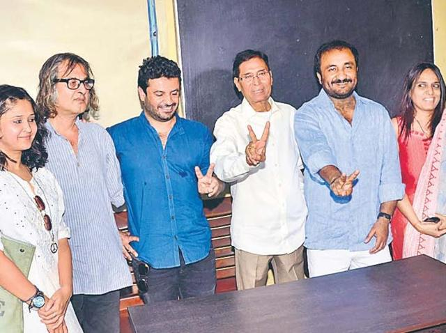 Director Vikas Bahl, producer Preeti Sinha, Sanjeev Dutt and others with Super 30 founder Anand Kumar at his residence, in Patna on Monday.