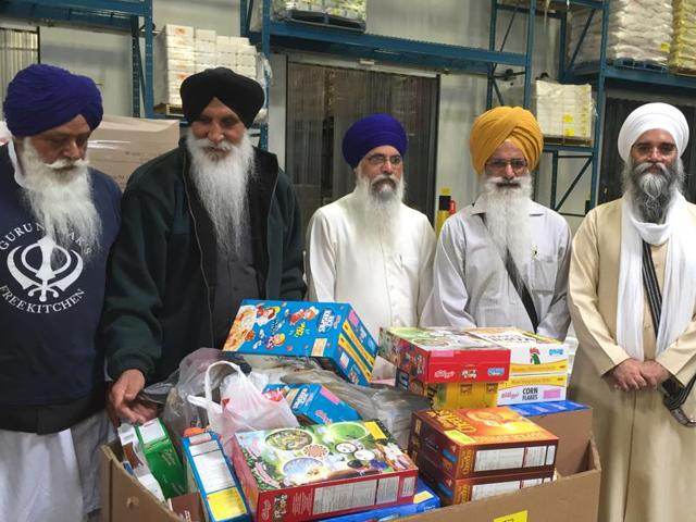 Temple leaders with the food items before the three trucks were dispatched.