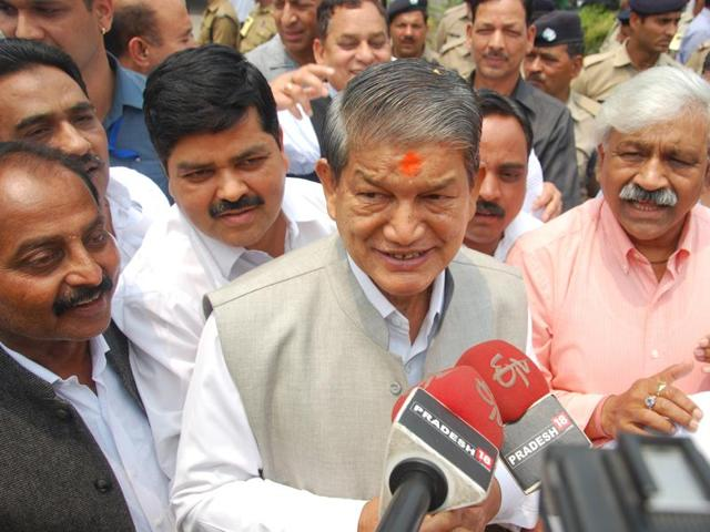 Harish Rawat speaks to the media after Tuesday's floor test.