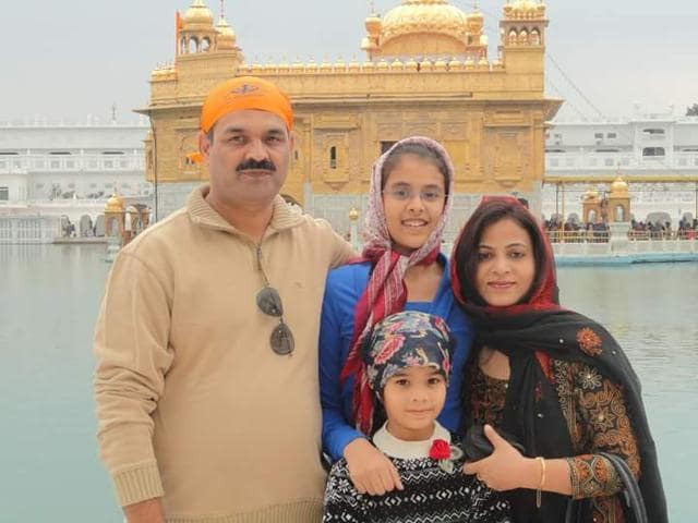 File photo of Kriti Tripathi (2nd from left) with her family. The 17- year- old committed suicide in Kota on April 28.