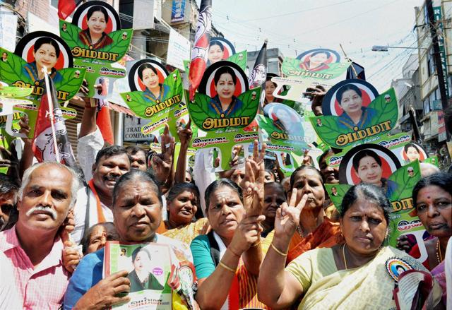 Supporters at an AIADMK campaign rally in Coimbatore. Income tax officials on Tuesday raided the houses of an AIADMKcandidate's associates.
