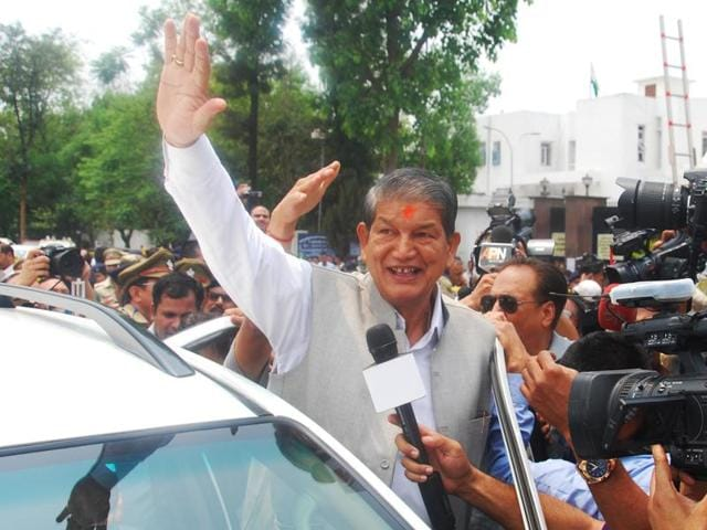 Chief minister Harish Rawat outside the assembly after floor test in Dehradun on Tuesday.